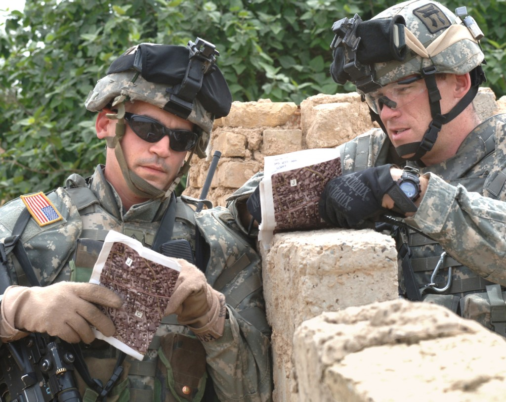 Sgt. 1st Class Brian Krcelic and Staff Sgt. Phanton from 1st Platoon, Alpha Company, 1st Battalion, 187th Infantry Regiment, 101st Airborne Division, discuss the progress of the mission while on patrol in Laq Laq, Iraq on April 11, 2006. The purpose of the mission was to gather intellegence on locals residing in the area. (Us Army photo by Spc. Charles W. Gill, 55th Combat Camera) (Released)